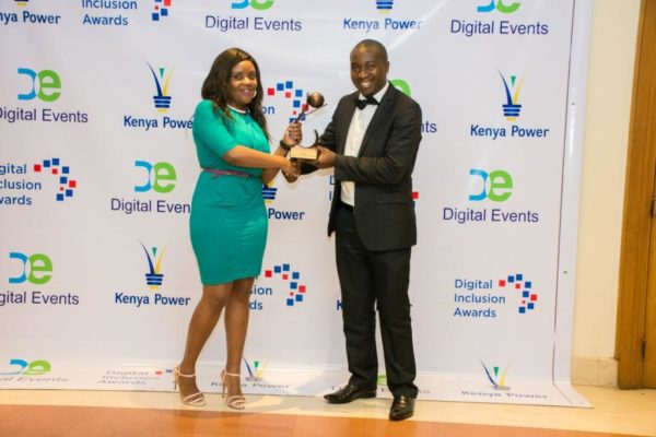 Left, OLX PR specialist, Sandra Buyole receiving award from Digital Awards Inclusion CEO, Wilson Wahome (Right)